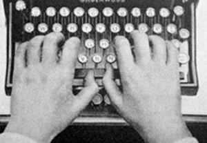 Hands on Typewriter, typing unbelief and atheism.